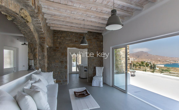 21_WhiteKey-Villa-Pearla-Mykonos-2nd_living_room_with_balcony-unrestricted_sea-garden_view.jpg